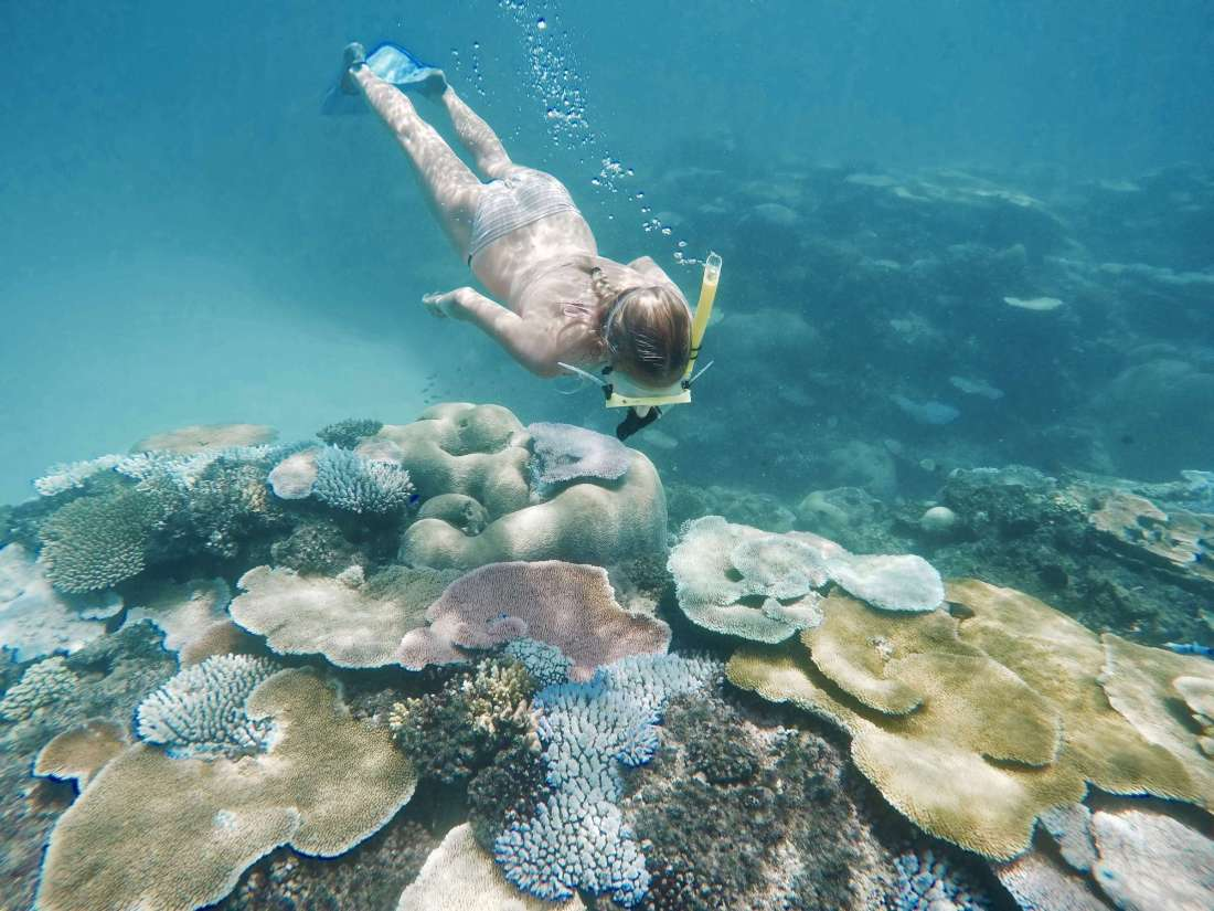 Woman exploring coral reef at Waya Island Fiji