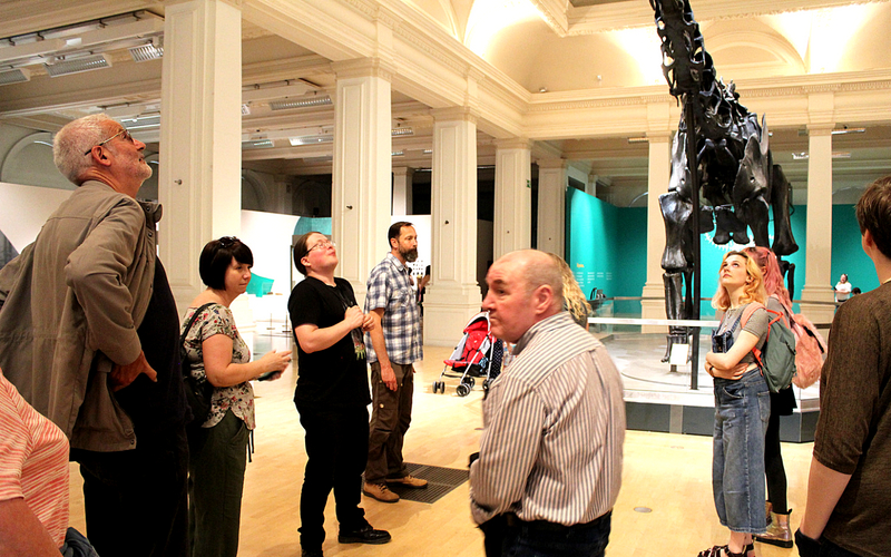 Guided tour people looking up at Dippy