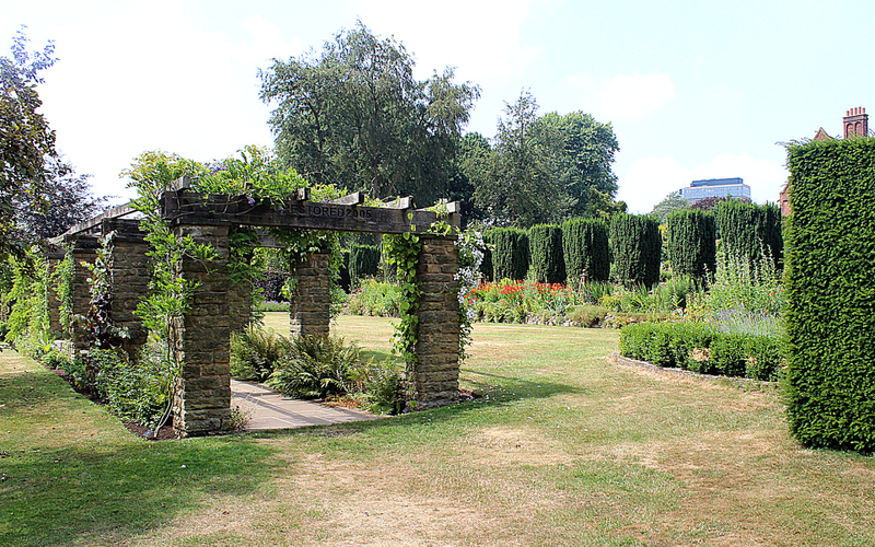 garden archway with flowers