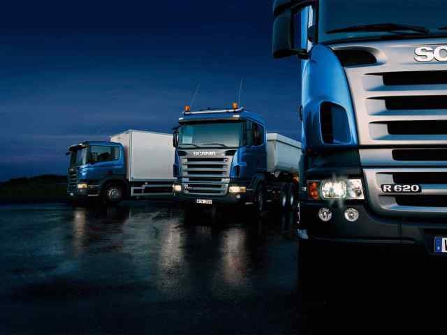 Three-trucks-on-blue-background.jpg?resize=640%2C480&ssl=1