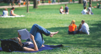 Student studying on lawn2 1.jpg 1175×780