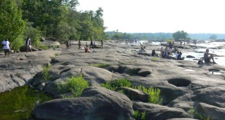 People on rocks of belle isle james river richmond virginia