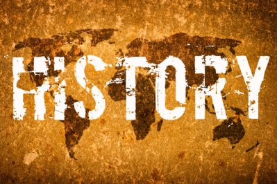 "Picture of the word ""History"" overlaying an aged world map"