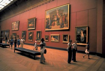 Picture of people looking at paintings in a gallery