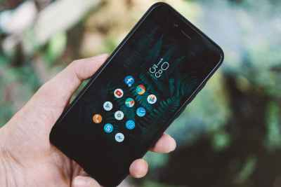 person holding black android smartphone with black case