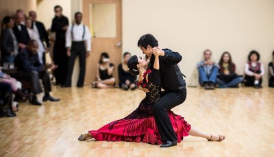 Ballroom dancers performing for a crowd.