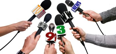 Microphones of various news outlets.