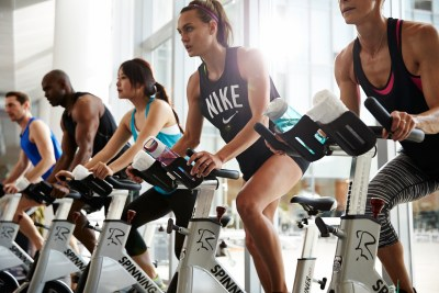 People participating in a cycling class.