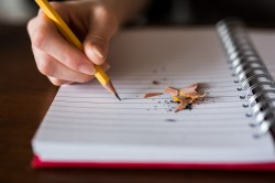 This image shows a student writing, which is a skill taught by Professor Nicholson.