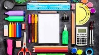 Set of school supplies including calculator, glue, pens highlighters, scissors, erasers, ruler, protractor and pencils