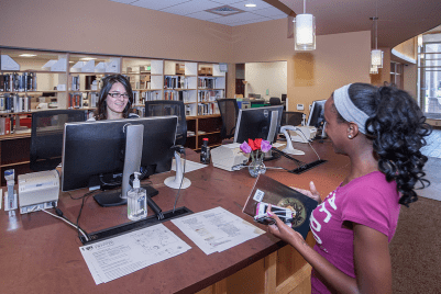 A student consulting a librarian