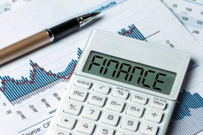 Finance: a pen, a calculator, and a performance graph