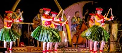 Hawaiian dancers performing at a luau