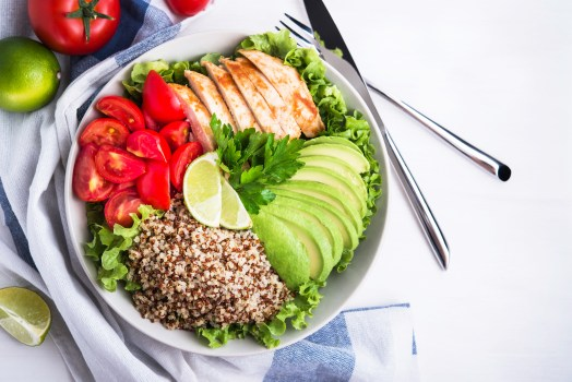 healthy foods consisting of avocados tomatoes, and lettuce