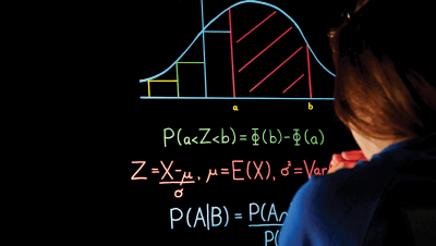 teacher in front of a mathematical graph relate to probability