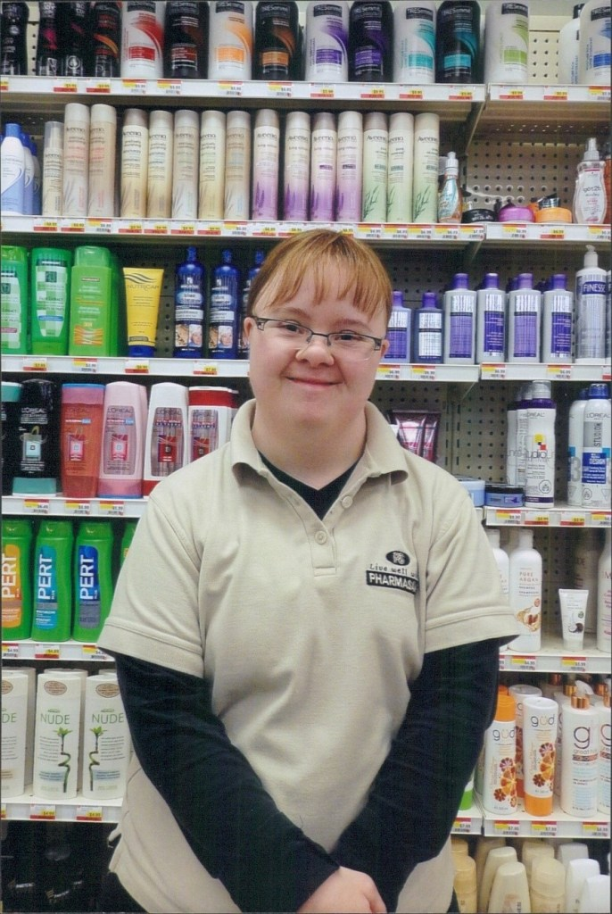 A learner working as a stockroom assistant