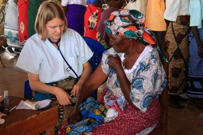 Nurse attending to a woman