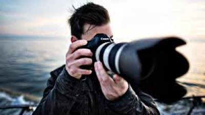 A person taking a picture with a camera