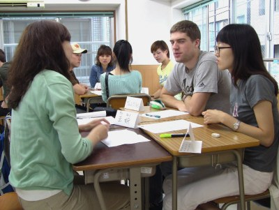 Students holding a small discussion meeting