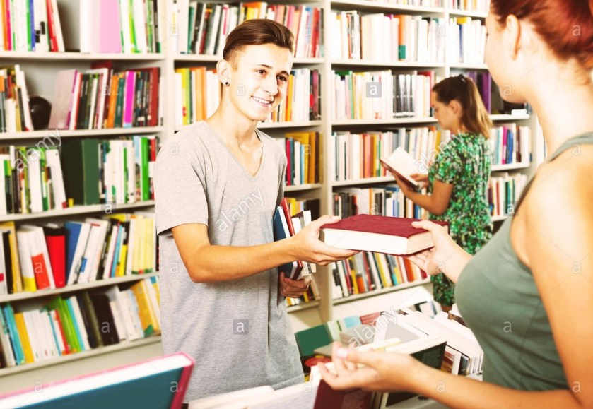 A student working as a bookseller
