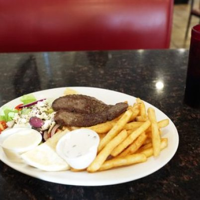 steak and fries with salad