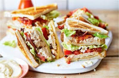 chicken club sandwich in plate