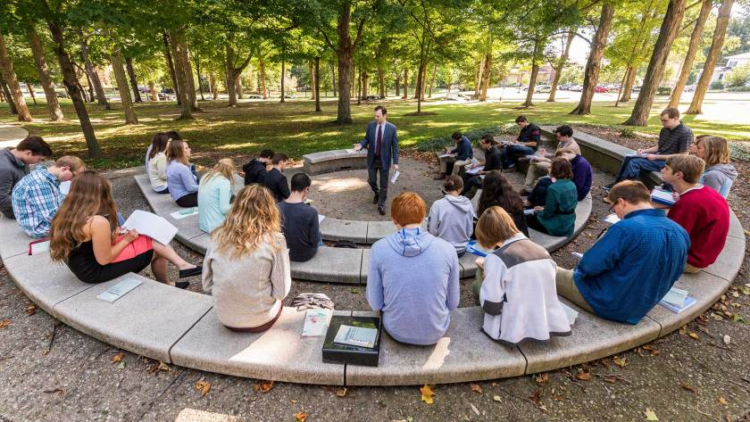 Students of Medieval literature studying outside