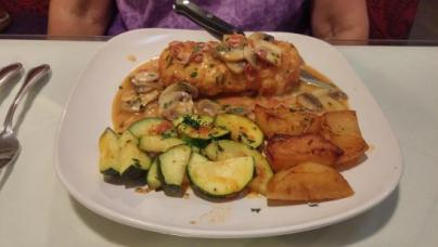a plate with potatoes and zuchini