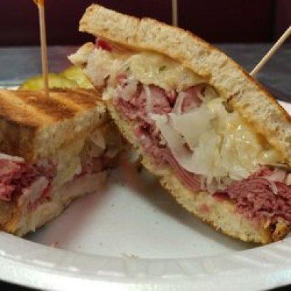 a rhuben sandwich with pickles
