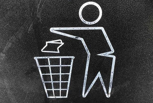 outlined image of person throwing out trash in the garbage bin.