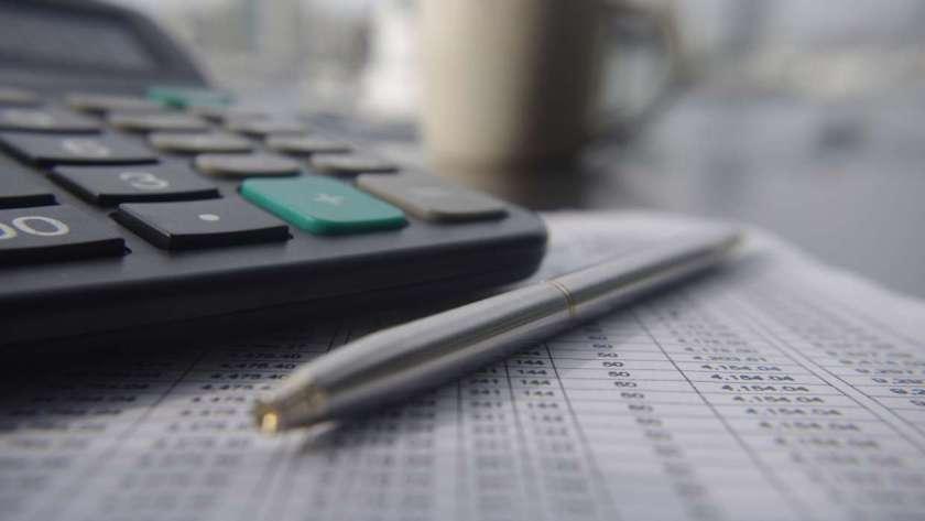 a balance sheet and a calculator