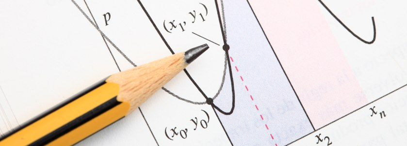 Picture of pencil on top of math function graph
