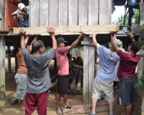 All hands help to raise the floor of our house-fit composting latrine.