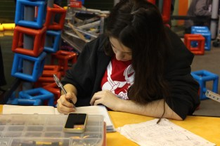 working-on-the-engineering-notebook-at-a-vex-robotics-competition