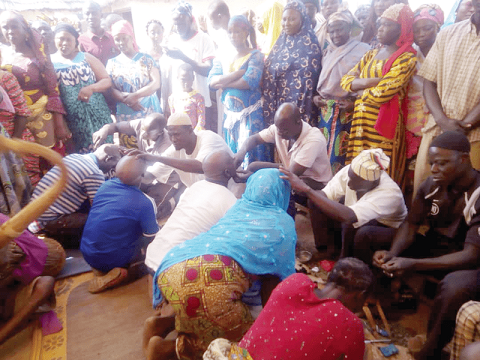 The wives and children of the late Yaa Naa Yakubu Andani being shaved as part of the funeral process