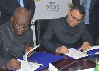 Mr Ken Ofori-Atta (left) and Mr Pushpesh Tyagi(right) signing the agreement