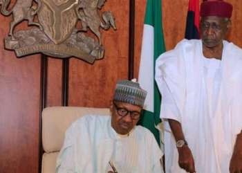 A handout image made available by the Nigerian State House shows the Nigerian president sitting beside his Chief of Staff Abba Kyari