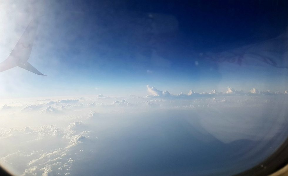 a view of clouds through a plane window