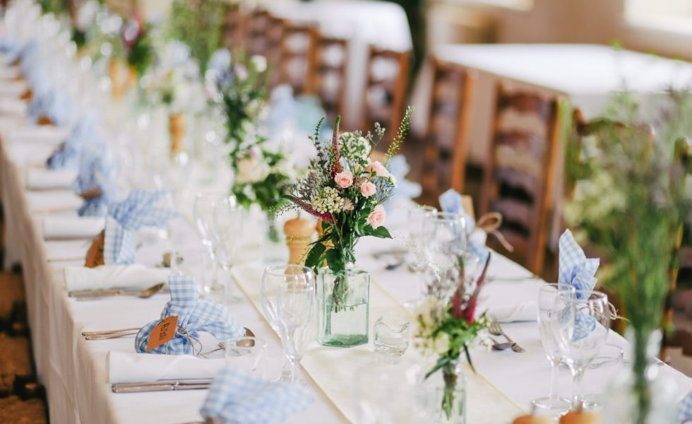 decorated wedding table and chairs with flowers