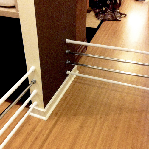 10 brilliant ways to use tension rods - easy to install portable pet or baby gate