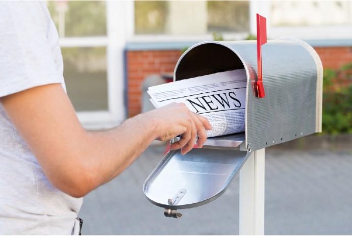 delivering newspaper mailbox