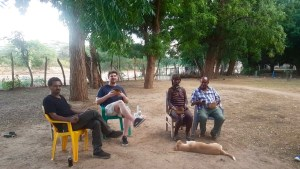 Sam Lumborg relaxing with locals with Ethiopia.