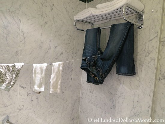 hanging clothes in bathtub