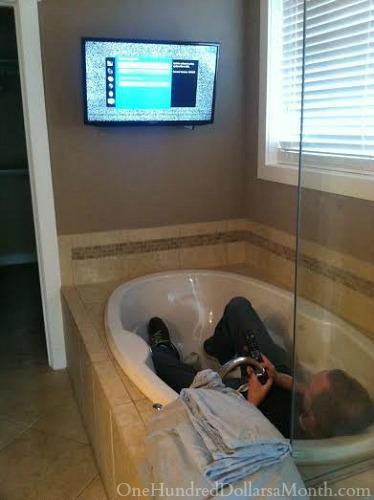 tv on bathroom wall