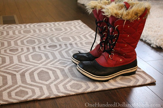 red sorell boots grey and white rug