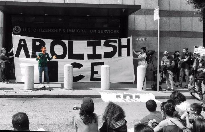 Edwin Carmona-Cruz speaks outside ICE Headquarters at a protest in San Francisco