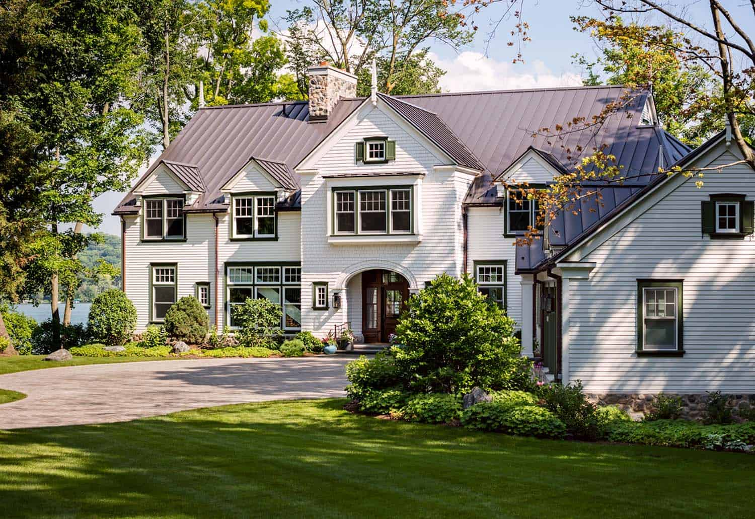 A gorgeous farmhouse style home on big cedar lake for Midwest house plans