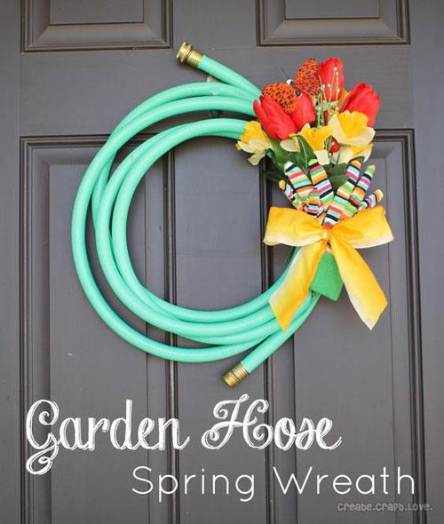 20 Best DIY Garden Crafts - Garden Hose Spring Wreath