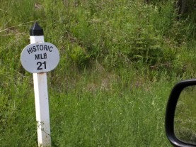 "Historic milepost. Clearly the original would not have said ""Historic"" on it. Current posts mark kilometers not miles."