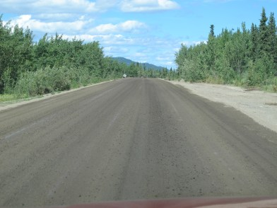 Muddy gravel, this road is close to being ready for pavement.